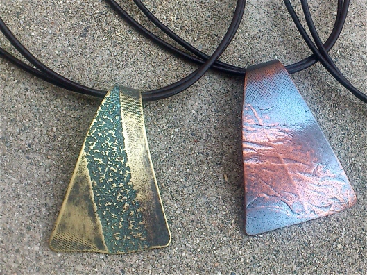 beach inspired roller printed copper and brass necklaces